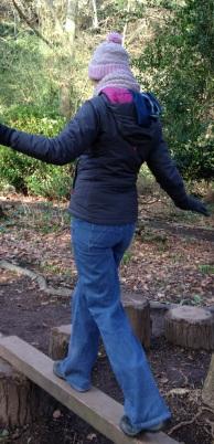 photo of Lorna walking along a low beam