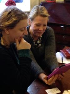 women looking at digital tablet