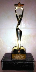 award shaped like a person holding a star