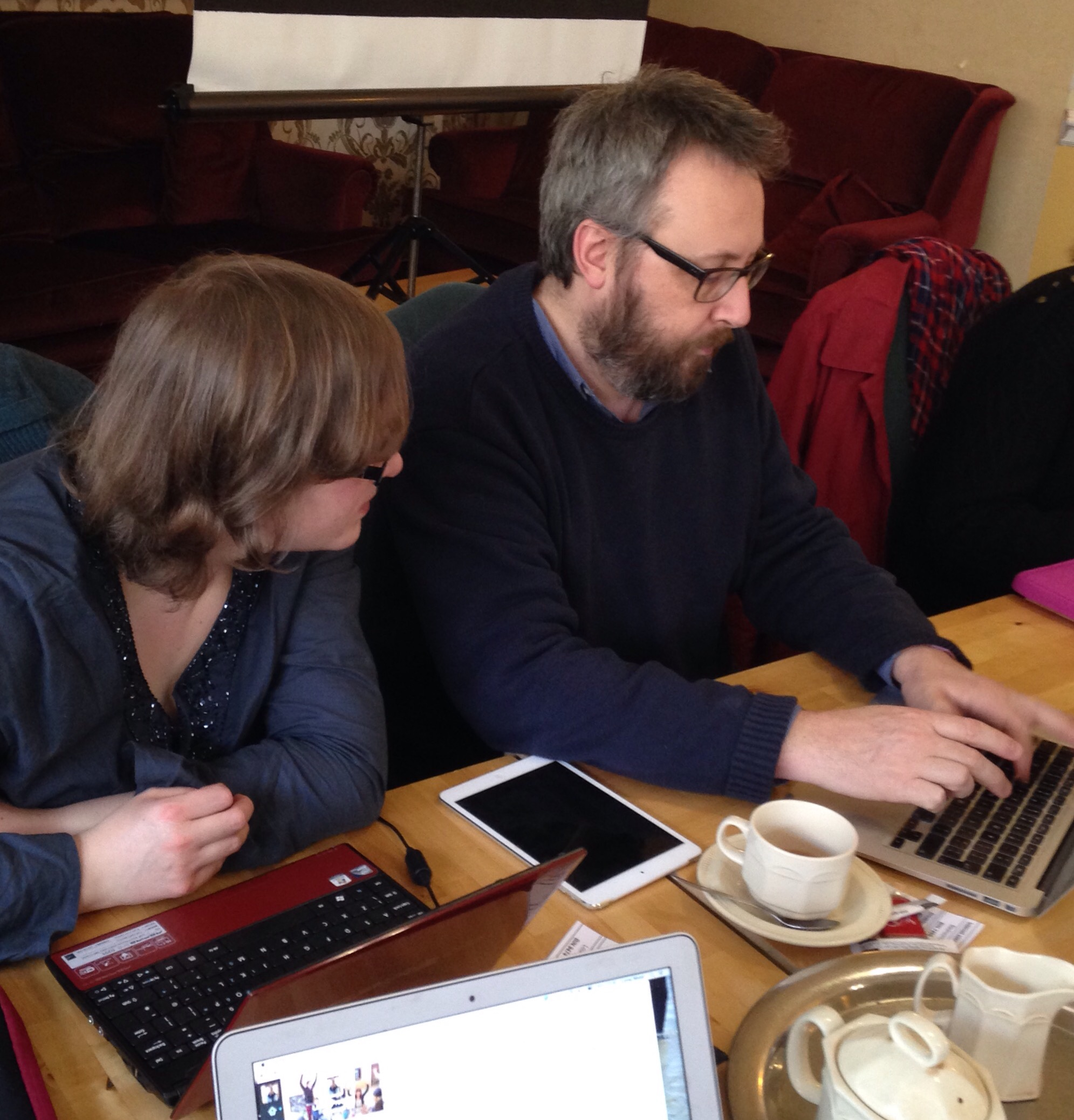 Photo of Becky and Nick working on a website on Nick's laptop