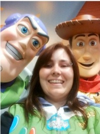 Photo of Claire with life-size Toy Story characters Buzz Lightyear and Woody